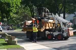 Photo courtesy of the city of Dearborn Workers remove flood-damaged materials from curbside on Sherwood Court.