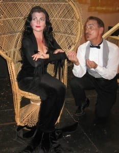 """Photo by Sue Suchyta. Allen Park residents Carolyn Sohoza (left), as Morticia and Chris Chavez as Gomez perform in """"The Addams Family – the Musical,"""" for two weekends, Oct. 16 to 25, with the Downriver Actors Guild. For tickets, call 313-407-7020 or go to downriveractorsguild.net."""