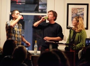 """Photo courtesy of Robert Fox. Author Robert Fox (left) drinks a vodka toast to his new book """"Love and Vodka"""" with Jon and Laurie Wilson, publishers for Fish Out of Water Books at the book's Nov. 11 release in Ann Arbor."""