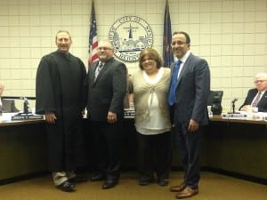 "Photo by Zeinab Najm. Ray Muscat (second from left), Lisa Hicks-Clayton and Wissam ""Dave"" Abdallah are presented to the audience at the Dearborn Heights City Council meeting after being sworn in by 20th District Judge David Turfe (left)."