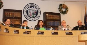 Photo by Sue Suchyta. The Melvindale City Council passed a resolution, based on a suggestion by Mayor Stacy Bazman (third from left) to rescind AFSME raises until the union ratifies its contract, which it has had had for a year, while City Clerk Diana Zarazua (left), City Administration Richard Ortiz, Attorney Lawrence Coogan and Councilman Wheeler Marsee listen.