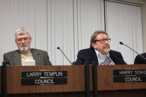 """Photo by Sue Suchyta. Councilman Larry Templin (left) listens during the Dec. 20 City Council meeting while Councilman Harry Sisko speaks about recent news reports where public officials were accused of """"conspiring to commit false pretenses,"""" circumstances he said can be compared to past events and officials that negatively impacted Allen Park."""