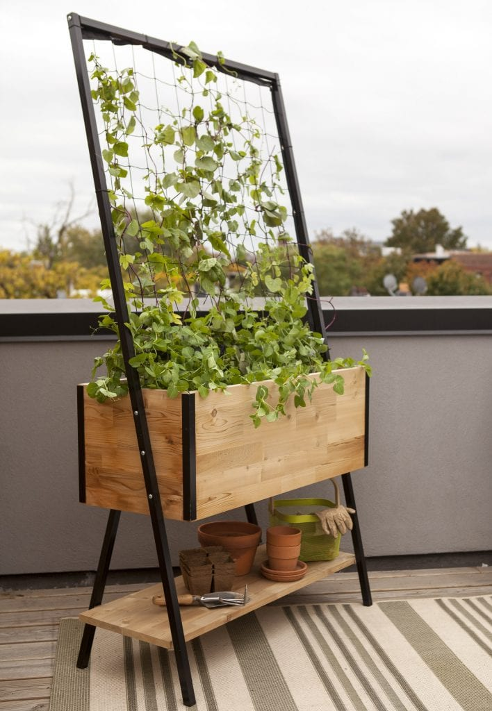 Photo courtesy of Gardener's Supply Co. Planter boxes with built-in trellises like this Apex trellis planter enable gardeners to maximize their garden space for growing vegetables and flowers.