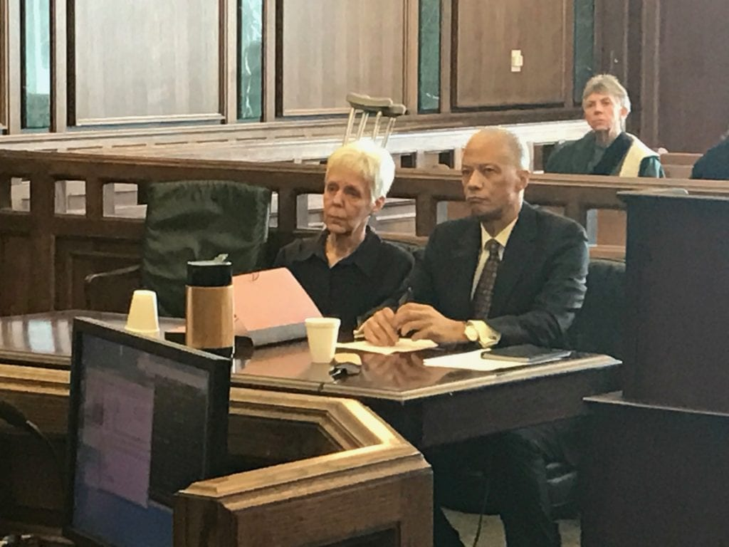 Photo by Zeinab Najm Former Dearborn City Clerk Kathleen Buda (left) and her attorney, Gerald Evelyn, listen to charges read in her district court arraignment Feb. 9.