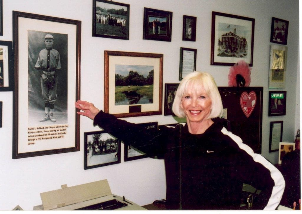 Photo courtesy of the city of Dearborn Then-Dearborn City Councilwoman displays a photo of her father, former Dearborn Mayor Orville L. Hubbard, as a child.