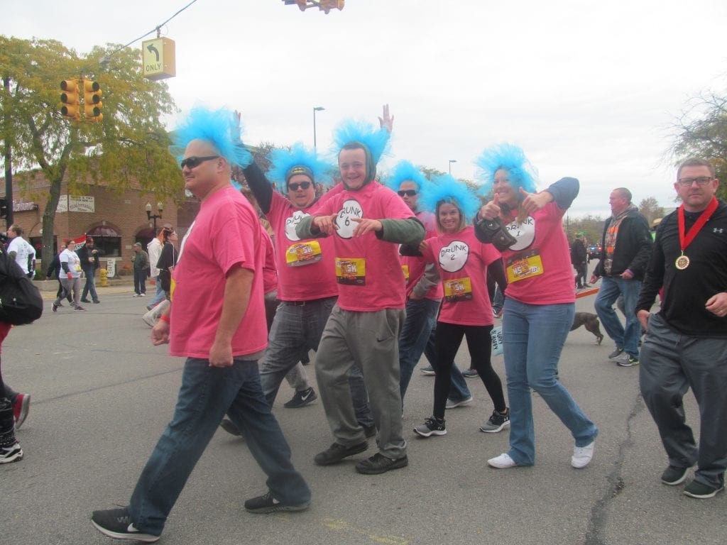 """Photo by Scott Brent The """"Dr. Seuss Drunks"""" finish the WRIF .5K run in style in Downtown Wyandotte Nov. 4."""