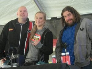 """Photo by Scott Brent Stars of WRIF-FM's """"Mark and Andy Show"""" Mark Pennington (left), Jade Springart and Andy Green broadcast the WRIF .5K run in downtown Wyandotte Nov. 4."""