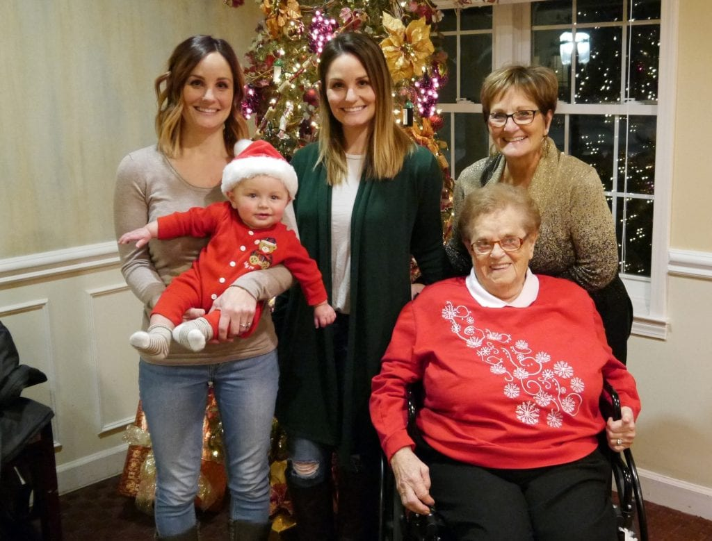 Photo courtesy of Oakwood Common Celebrating four generations of family at Oakwood Common's holiday party is Jameson Doran, six months, in the arms of his mother, Joey Doran (left); her twin sister, Alex Brandt; mother and Oakwood Common sales manager, Donna Brandt; and great grandmother and resident, Ann Hustik.