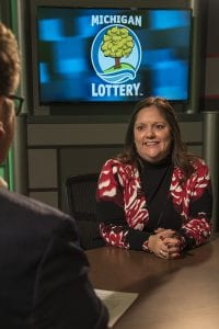 Photo courtesy of the Michigan Lottery Public Relations Division Kerri Moccio is interviewed after being presented with an Excellence in Education award from the Michigan Lottery.