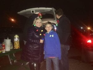 Photo by Scott Brent Marlene Cottrell (left) and Alexander Cottrell tailgate from their trunk as they await the Holiday Train in Allen Park Nov. 30.