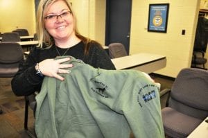 Photo courtesy of the city of Taylor Shannon Edwards displays one of the hoodies presented to her and her family by Danny McWilliams.