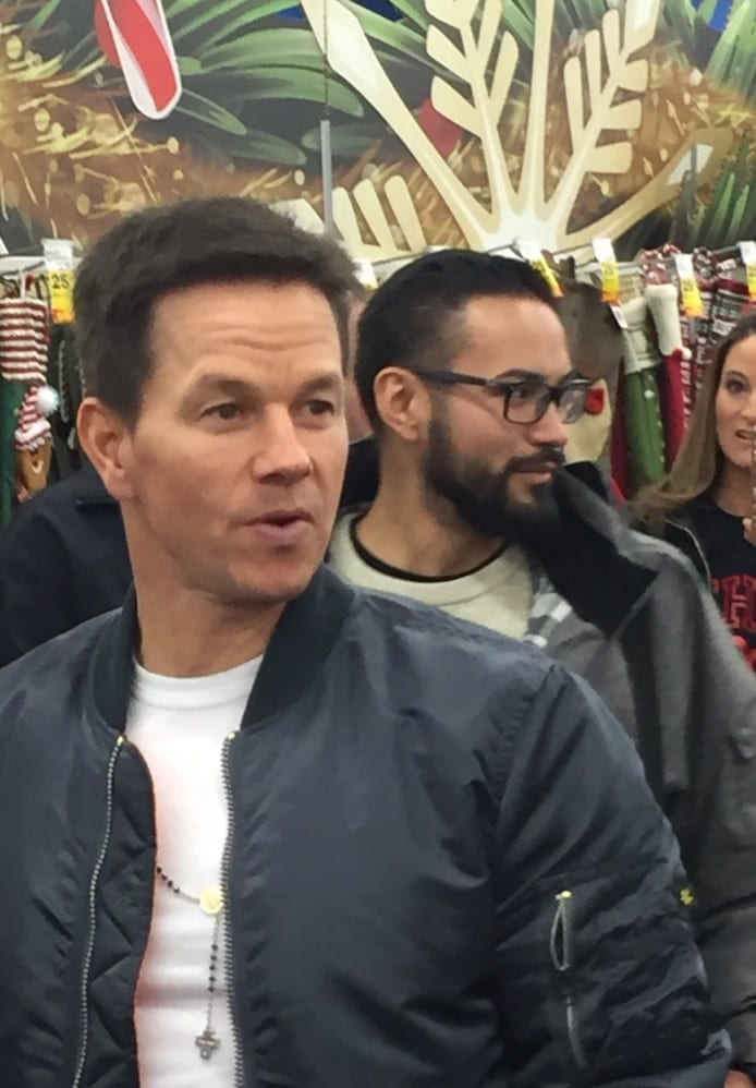 Photo courtesy of Jennie Metivier Mark Wahlberg (left), actor and co-founder of Wahlburger's, enters Meijer to promote the two companies' partnership Dec. 15.