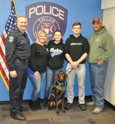 Photo courtesy of the city of Taylor Taylor Police Chief John Blair (left) oversees the presentation of Preston by The Thin Blue Line Dog Project founder Danny McWilliams (right) to Shannon (second from left), Moriah and Luke Edwards at the Taylor Police Department.