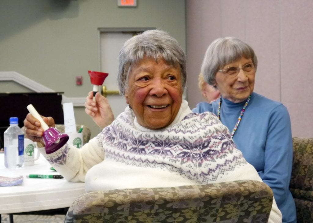 Photo courtesy of Beaumont Personal Assistance Services Oakwood Common residents Otherie Love (left) and Mary Ann Bassett wait for color coded cues to ring bells during the Healthy Aging Healthy Brain workshop.