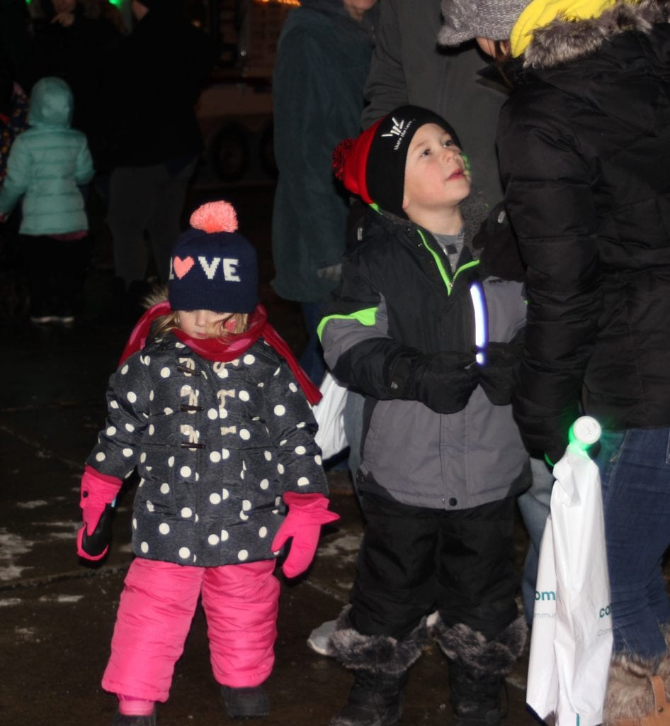 Emma Hill, 3, and her brother Noah, 6, of Grosse Ile Township await the 9 p.m. ball drop.