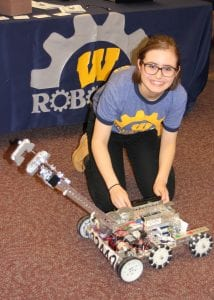 Photo by Sue Suchyta Maria Bora, 12, of Wyandotte works with the Wilson Middle School robotics team Jan. 12 at a family tech night at Bacon Memorial District Library in Wyandotte.