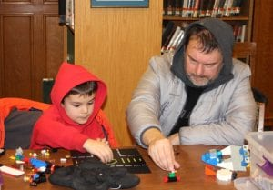 Photo by Sue Suchyta Evan Wolak (left), 5, of Wyandotte and his father, Dan, build with Lego at a family tech night.