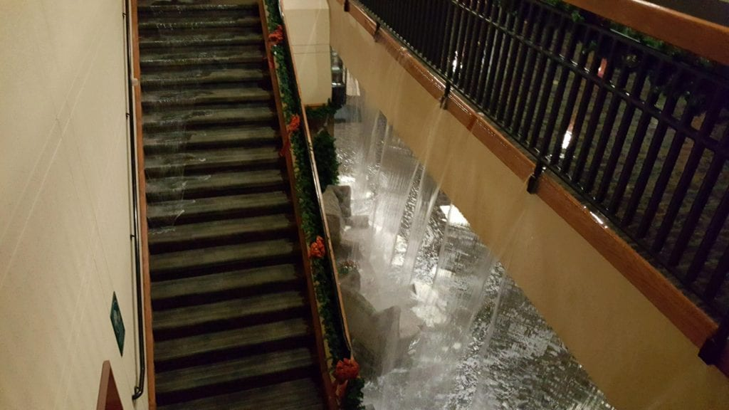 """Photo courtesy of the city of Taylor Water cascades from one floor to the next at the Lakes of Taylor Golf Clubhouse Dec. 28, where a fire suppression line got too cold near the front of the roof line and the line """"gave way,"""" causing extensive water damage."""