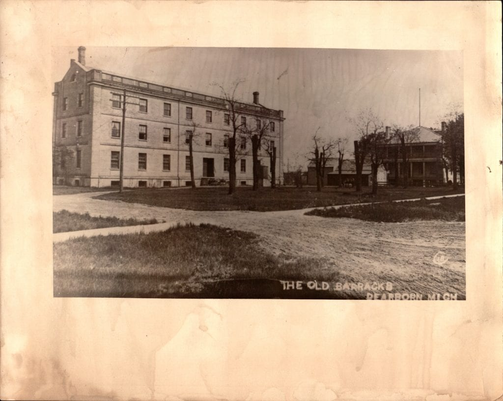 Photo courtesy of the Dearborn Historical Museum  Two former arsenal structures, the armory (left) and the Commandant's Quarters, are pictured in 1902. By this time, the Arna Woolen Mills Co. had converted the armory (left) to a production company where imitation buffalo robes and blankets were made. The Commandant's Quarters today is part of the Dearborn Historical Museum's campus.