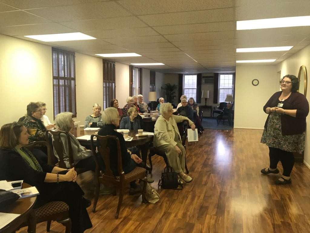Photo by Zeinab Najm Vista Maria Associate Manager of Volunteer Resources Becky Herman (right) gives a presentation on human traf cking during the American Association of University Women-Dearborn annual meeting Jan. 23 at Christ Episcopal Church.