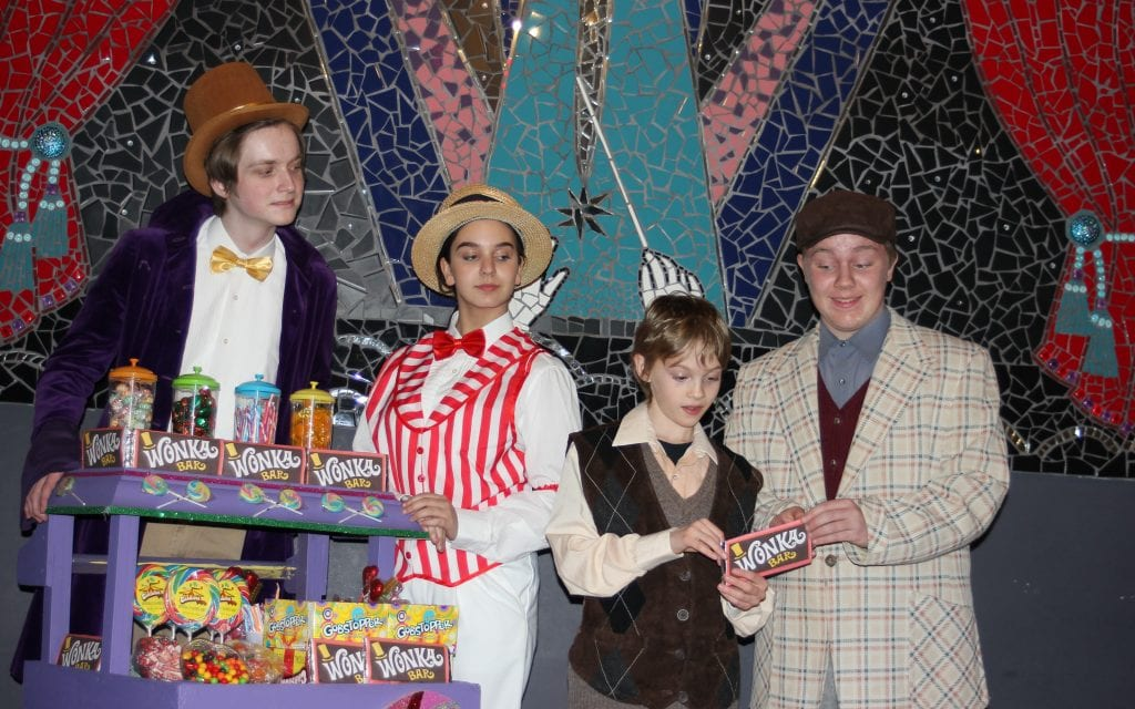 """Photo by Sue Suchyta The Downriver Actors Guild presents the Roald Dahl musical, """"Willy Wonka"""" Feb. 16 to 25, with Daniel Kessler (left), of New Boston as Willy Wonka, Madison Ganzak of Dearborn Heights as the Candy Man, Dresden Keding of Grosse Ile Township as Charlie Bucket and Leo Hellar of Brownstown Township as Grandpa Joe. For tickets or more information, call 734-407-7020 or go to downriveractorsguild.net."""