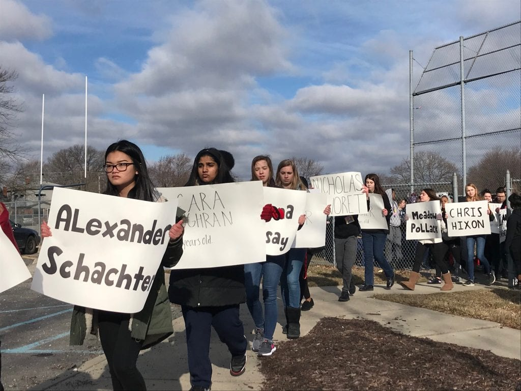 Photo by Zeinab Najm Annapolis High School students carry signs with the names of the 17 Stoneman Douglas High School shooting victims during a 17-minute walkout that took place nationwide March 14.