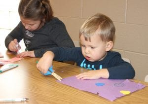 Photo by Sue Suchyta Aubrey Scharnhorst (left), 7, and her brother Blake, 3, of Dearborn Heights, make Valentines Feb. 12 at Southgate Veterans Memorial Library, 14680 Dix Toledo Road.