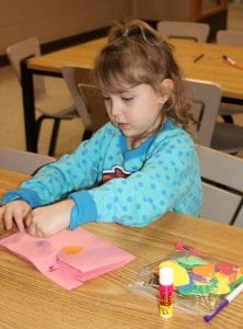 Photo by Sue Suchyta Riley Thompson, 4, of Southgate makes a valentine card Feb. 12 at Southgate Veterans Memorial Library, 14680 Dix Toledo Road.