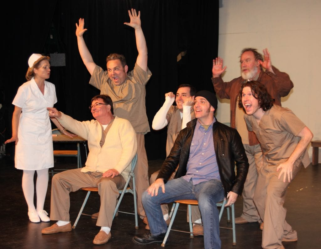 """Photo by Sue Suchyta The Downriver Actors Guild presents """"One Flew Over the Cuckoo's Nest"""" March 16 to 25, with Carolyn Sohoza (left) of Dearborn as Nurse Ratched, Gary Jenkins of Monroe as Harding, Ronald Roberts of Monroe as Cheswick, Brian Aue of Taylor as Billy Bibbit, Leo McMaster of Rockwood as McMurphy, Rob Eagal of Trenton as Scanlon, and John Bruske of Lincoln Park as Martini. For tickets or more information, call 734-407-7020 or go to downriveractorsguild.net."""