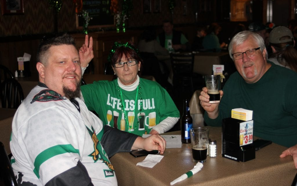 "Photo by Sue Suchyta Joseph Martin Jr. (left), Debra Maynard and Joseph Martin Sr. celebrate St. Patrick's Day at Brooklyn's, 1254 Eureka, known as the ""Cheers of Wyandotte."""
