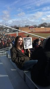 Photo courtesy of Kathi Cuschieri Anderson student Emmelie Byers holds a picture of Anderson art teacher Jacqueline McKay to show teacher support during the March 14 walkout.