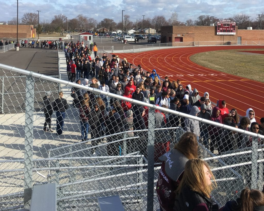Photo courtesy of Kathi Cuschieri Students file into the bleachers during the March 14 walkout at Anderson High School.