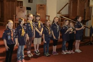 Dearborn Cub Scout Pack 1112 leaders celebrate Elizabeth Woodlley, 7 (left); Eleanore Jezewski, 8; Rosemary Calder, 8; Caroline Kuentz, 8; Courtney Ehnis, 8; Gabriella Schneidt, 8; Lillian Britt, 6; Luna Britt, 9; and Alice Ferguson, 9, who were the first girls to be inducted into the pack during a ceremony May 1 at First United Methodist Church.