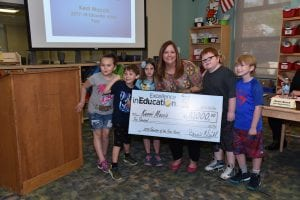 Photo courtesy of the Michigan Lottery Bedford Elementary School first grade literacy intervention specialist teacher Kerri Moccio poses with her students after she was surprised with the Michigan Lottery 2018 Excellence in Education of the Year during the D7 board meeting at Bedford Elementary School May 16.