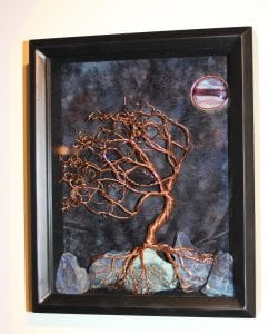 Framed sculpture with glass.