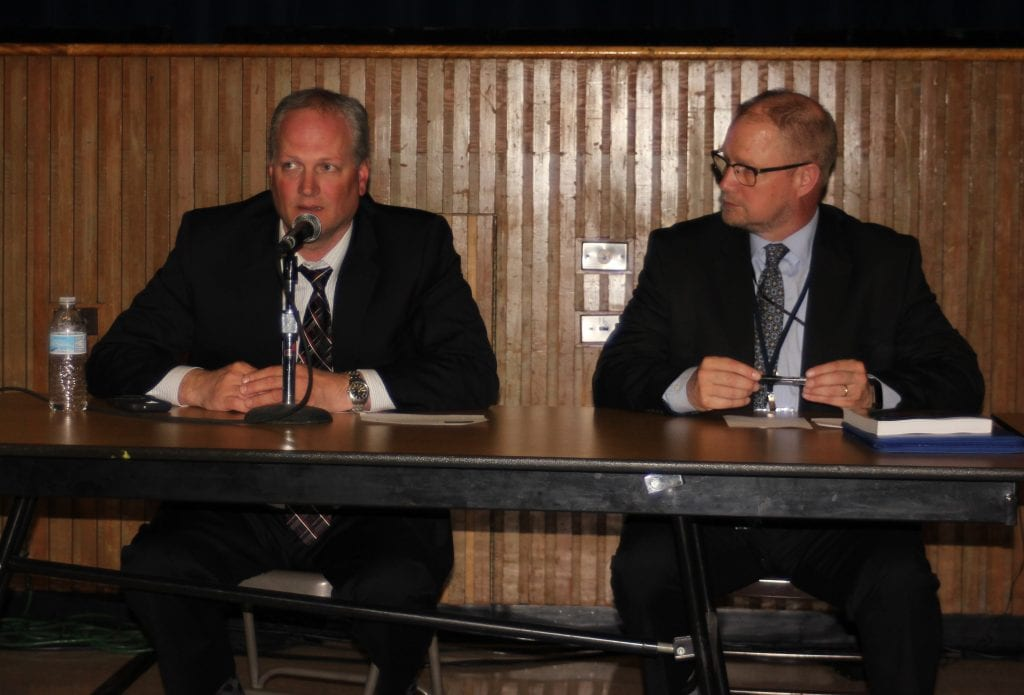 Photo by Sue Suchyta Trenton Director of Police and Fire Services Steven Voss (left) answers questions April 24 at a school safety forum as Trenton Public Schools Supt. Rod Wakeham listens.