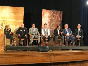 Facebook photo courtesy of Inaya Soufan Shehab U.S. Rep. Debbie Dingell (D-Dearborn, left), Dearborn Police Chief Ronald Haddad, Dearborn Public Schools Supt. Glenn Mayleko, state Rep. Abdullah Hammoud (D-15th District), Wayne County Sheriff Benny Napoleon, attorney and gun rights advocate James McSkousty and U.S. Attorney for the Eastern District of Michigan Matthew Schneider answer questions during a WXYZ Channel 7 school safety town hall at Fordson High School on April 30.