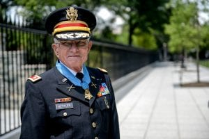 Retired U.S. Army Lt. Col. Charles Kettles is awarded the Medal of Honor at the White House in Washington, D.C., July 18, 2016, for actions during a battle near Duc Pho, South Vietnam, on May 15, 1967. Then-Maj. Kettles, assigned to 1st Brigade, 101st Airborne Division, was credited with evacuating dozens of Soldiers in a UH-1D Huey helicopter under intense enemy fire. (U.S. Army photo by Sgt. Alicia Brand)