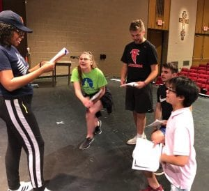 "Photo courtesy of Kevin Briggs Students from the high school cast rehearse a scene for Divine Child High School's production of Disney's ""High School Musical Jr.,"" which runs June 28 to 30. For tickets or more information, go to divinechildhighschool.org."