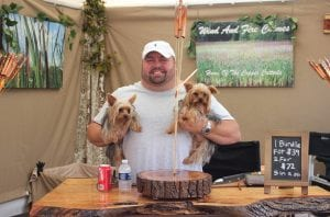 Jaron Reeser, of Wind and Fire Chimes of Columbus, Ohio, with his Yorkies, Nelson (left) and Petey, was a victim of a larceny in the early morning hours of July 14, when $7,020 worth of wind chimes were stolen from his booth.