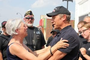 """Photo by Sue Suchyta Downriver for Veterans founder Ann Rudisill (left) shares an emotional moment Aug. 27 with reality show personality Mike Rowe, whose reality show, """"Return the Favor,"""" did a weekend makeover of local non-profit """"Downriver for Veterans."""""""