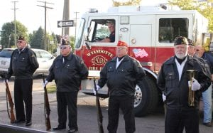 Photo by Sue Suchyta The Wyandotte Veterans Honor Guard participates in a 9/11 remembrance at Veterans of Foreign Wars Post 1136 Sept. 11.