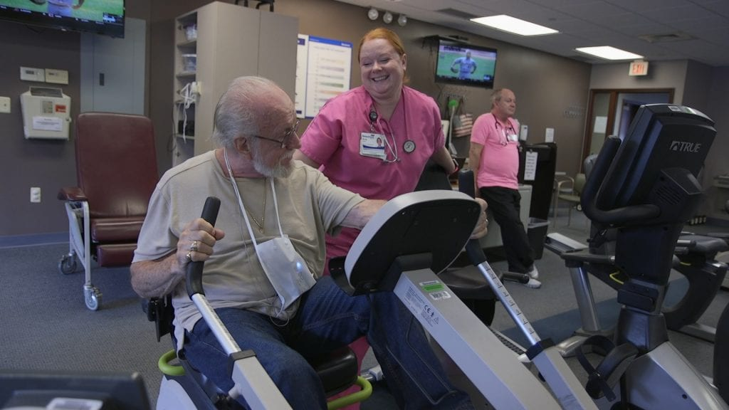 Photo courtesy of Beaumont Health     Robert Empson (left) performs cardiac rehabilitation exercises with Amy Fritz, senior exercise physiologist at Beaumont Hospital, Dearborn.
