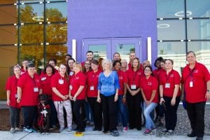 Photo courtesy of the Friends for Animals of Metro Detroit  Friends for Animals of Metro Detroit Board Chair MaryAnn Wright (center) poses with staff from the animal shelter during the opening of the MaryAnn Wright Animal Adoption and Education Center Sept. 18.