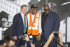 Bill Ford, executive chairman, Ford Motor Company, left, and Rory Gamble, vice president, UAW, right, congratulate Willie Fulton, Jr., on 65 years at Ford. Fulton is the longest tenured employee at the company.