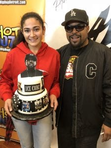 Photo courtesy of Aya Islim Dearborn resident and baker Aya Islim (left), 14, presents rapper and actor Ice Cube with a cake she created during his appearance Sept. 28 at Al-Wissam, 13354 Michigan Ave.