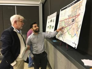 Photo by Zeinab Najm Dearborn residents and business owners discuss aspects of the city's proposed Multimodal Transportation Plan during a public meeting Oct. 17 at the John D. Dingell Transit Center.