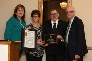 Photo by Robert Ankrapp Life-long Dearborn Heights resident Gary Barkoff (third from left) and his wife, Sharon (second from left), receive congratulations from Wayne County Commissioner Diane Webb (left) and Dearborn Heights Mayor Dan Paletko (right) on his recognition as Dearborn Heights Senior Citizen of the Year during the city's recent Volunteer Recognition Luncheon. Barkoff was also recognized shortly after as the recipient Michigan Parks and Recreation Association's 2018 Margaret Whitehead Senior Citizen of the Year award.