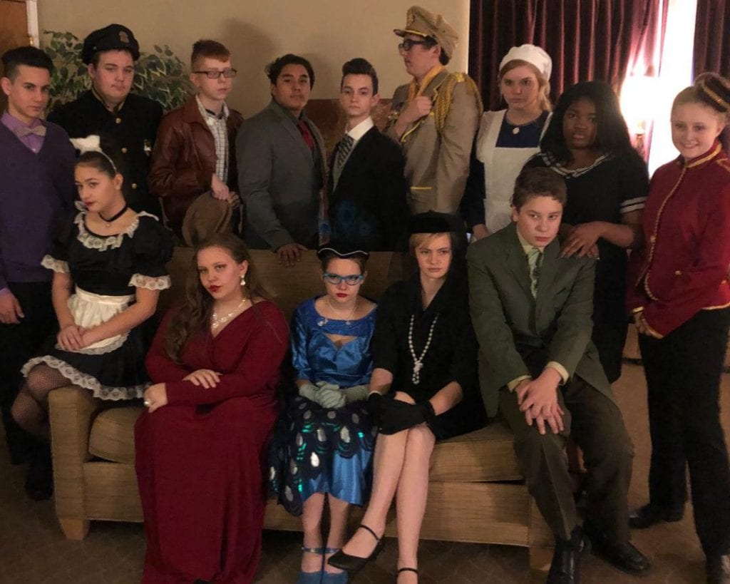 """Photo courtesy of Edsel Ford High School Theatre Department  Edsel Ford High School presents """"Clue: On Stage"""" (high school edition) 7 p.m. Nov. 29 and 30 and Dec. 1 at the EFHS, 20601 Rotunda, Dearborn, with Leslie Adams (front row left) as Yvette, Lily Kanclerz as Miss Scarlet, Abbie Pitts as Mrs. Peacock, Nora Heaton as Mrs. White, Chris Adams as Mr. Green, Kyla Heaton as the Singing Telegram Girl, Hasen Alnakash (back row left) as Professor Plum, Cameron Conolly as a cop, Andrew Bard as the motorist, Oscar Vasquez as Mr. Boddy, Nathan Wall as Wadsworth, Griffin Ziembowicz as Colonel Mustard, Molly Mullen as Cook, and Lataysia Lacey as the agent. Tickets are $8, with a $2 discount for students and seniors. To order, go to EFHSclue.brownpapertickets.com or purchase tickets at the door."""