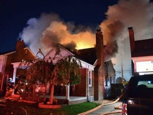 Photo by Ian Kushnir  Dearborn Heights firefighters respond to a house in the 6900 block of Mayburn Oct. 29.